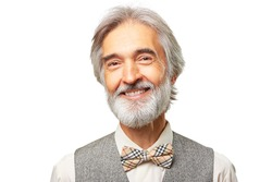 Portrait of smiling aged caucasian man with a gray beard and bowtie isolated on white background.