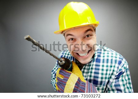 Portrait of smiling architect with electric drill