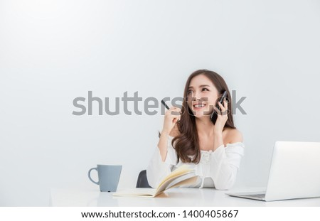 Portrait of smiling beautiful business asian woman working in office using computer with copy space. Business people freelance online marketing e-commerce telemarketing she concept