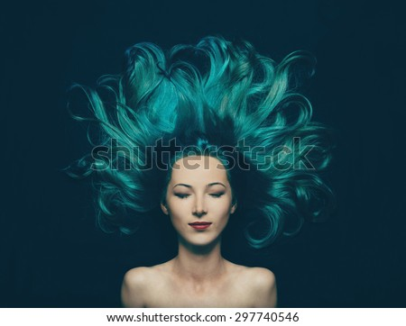 Stock Photo Portrait of smiling beautiful girl with closed eyes and long hair of turquoise color, top view. Image of mermaid