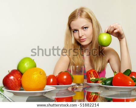 Portrait of smiling beautiful girl with vegetable and fruit