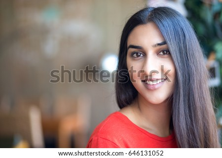Portrait of smiling beautiful Indian woman