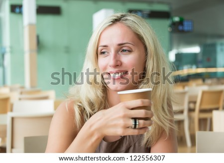 Portrait of smiling beautiful woman having cup of coffee #122556307