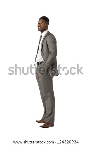 Portrait of smiling black businessman against white background