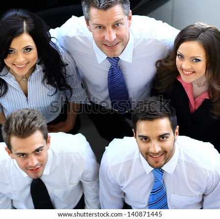 Portrait of smiling business people. Top view