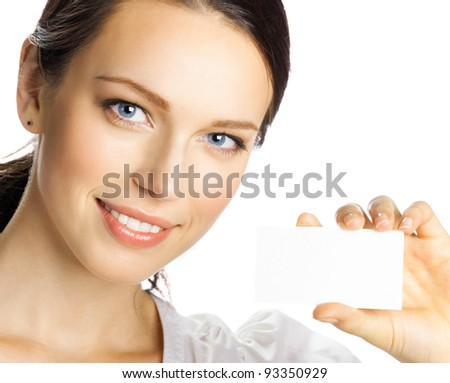 Portrait of smiling business woman giving blank business card, isolated over white background