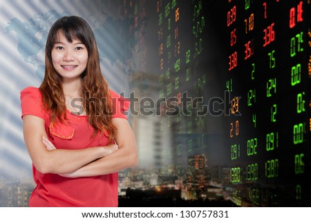 Portrait of smiling business woman . over stock exchange and buildings background