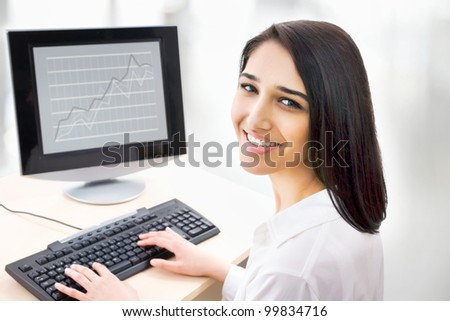 Portrait of smiling business woman with computer