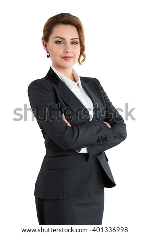 Portrait of smiling business woman with folded hands isolated on white background. Female wearing grey formal suit standing with her arms crossed. Business lifestyle and success concept stock photo