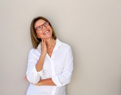 Portrait of smiling business woman with glasses looking up