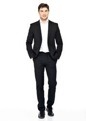 Portrait of smiling businessman in black suit casual  poses at studio