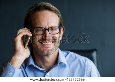 f423a8283a22 Portrait of smiling businessman talking on phone in office #458732566 · Nerd  silly retro teacher man with braces funny expression bow tie ...