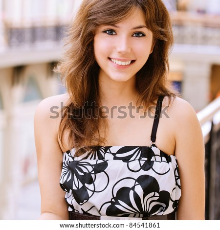 Portrait of smiling charming young woman.