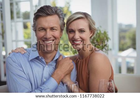 portrait of smiling couple...