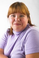 portrait of smiling fat woman on gray background