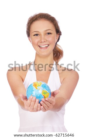 portrait of smiling girl posing with globe