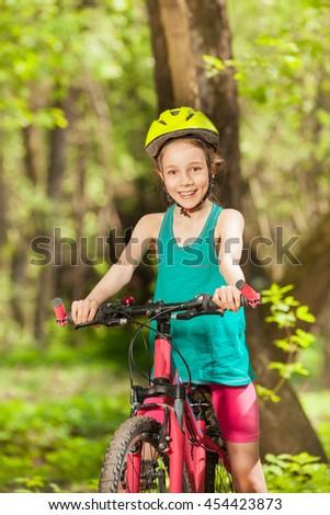 Portrait of smiling girl riding her mountain bike #454423873