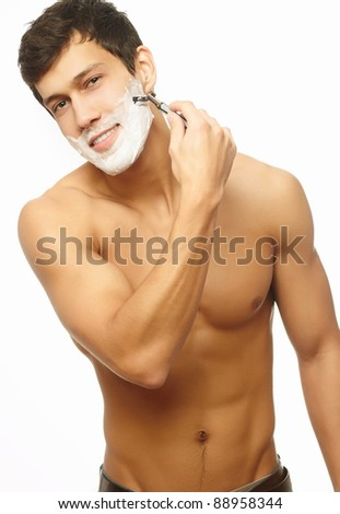 Portrait of smiling handsome successful shaving man  isolated on white background