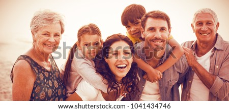 Portrait of smiling happy family posing at beach