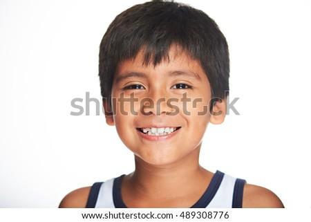 portrait of smiling hispanic boy isolated on white