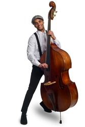 Portrait of smiling jazzman. Holding old contrabass, wearing suspenders and flat cap, white background. Hipster musician, swing, blues.