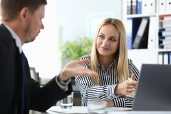 Portrait of smiling lady working in modern office. Cheerful business woman discussing advantages disadvantages of contract with partner. Biz concept. Blurred background
