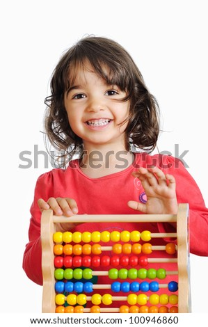 Portrait of smiling little girl with colorful abacus