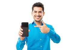Portrait of smiling male showing off his new mobile phone against white background