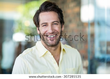 Portrait of smiling man at shopping mall