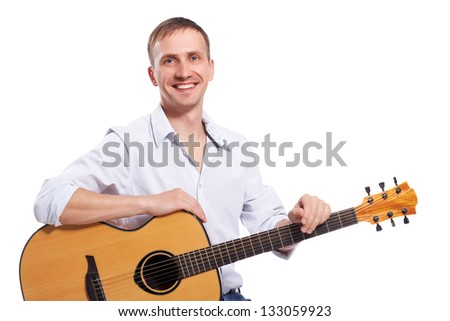 Portrait of smiling man with acoustic guitar isolated on white background