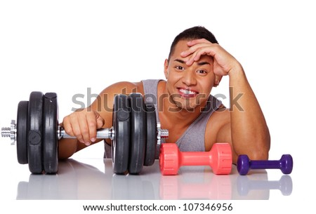 Portrait of smiling man with dumbbells