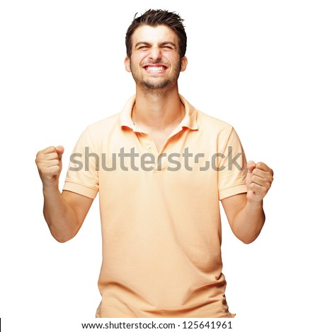 Portrait Of  Smiling Man With The Fists Up Against A White Background #125641961