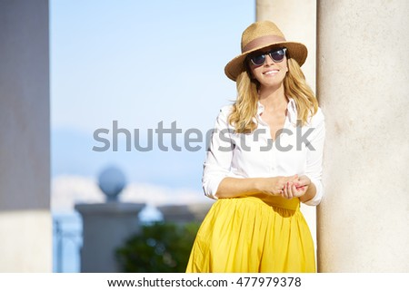 Portrait of smiling mature beauty relaxing outdoors and feeling great on a perfect summer day. #477979378