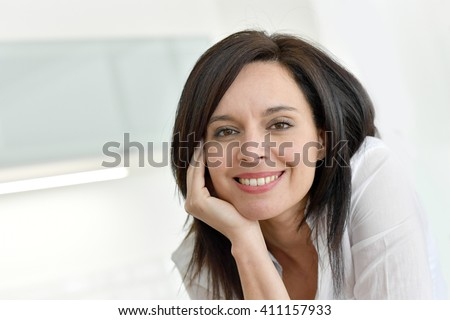 Portrait of smiling mature dark-haired woman