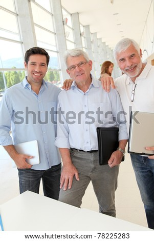 Portrait of smiling men in business training