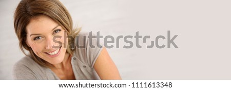 Portrait of smiling middle-aged woman, template