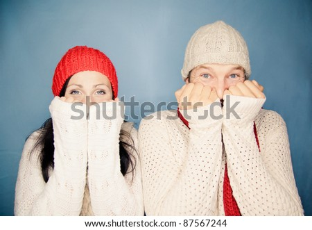 portrait of smiling mouth tapping couple looking in camera with opened eyes