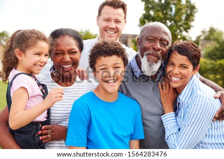 Portrait Of Smiling Multi-Generation Mixed Race Family In Garden Stock photo ©