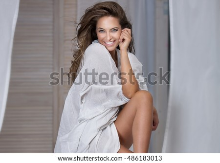 Portrait of smiling natural adult woman with long hair. Natural look.