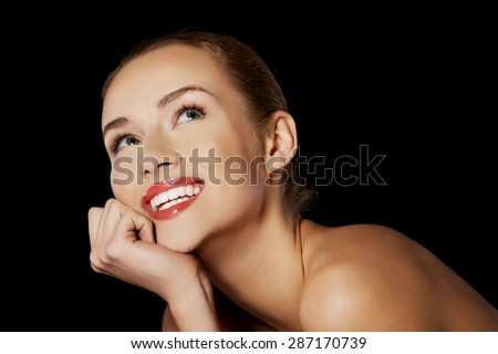 Portrait of smiling nude woman on dark background. #287170739
