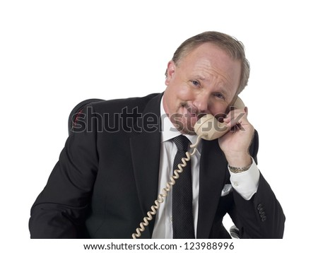 Portrait of smiling old business man talking to the phone against white background