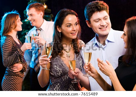 Portrait of smiling people interacting each other at a party