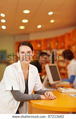 Portrait of smiling pharmacist in a pharmacy