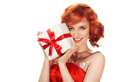 Portrait of smiling red hair woman holding gift box. Isolated on white.