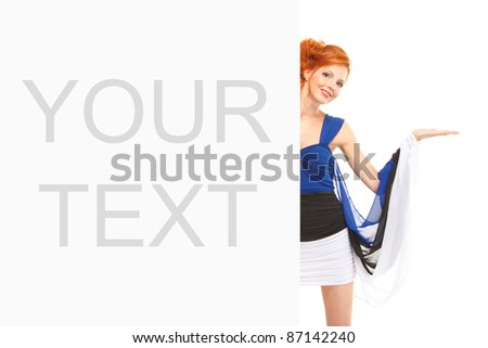 portrait of smiling redhead girl wearing estonian flag dress near the billboard with outstretched her hand like she is presenting something over white background