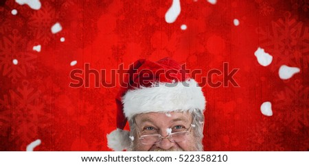 Portrait of smiling Santa Claus against red paint splatter background #522358210