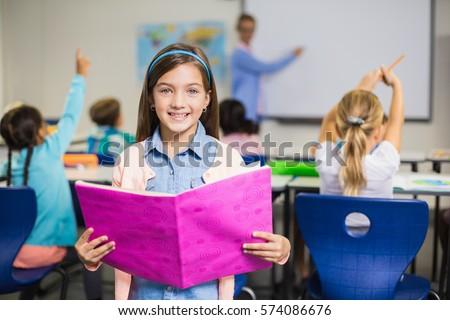 portrait of smiling schoolgirl...