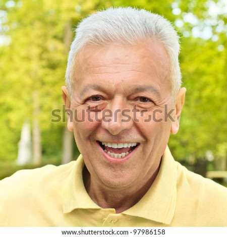 Portrait of smiling senior man outdoors.