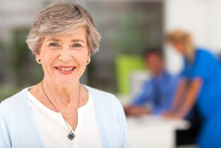 portrait of smiling senior woman in doctor's office