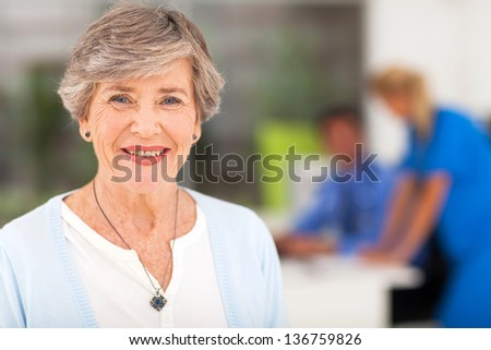 portrait of smiling senior woman in doctor\'s office